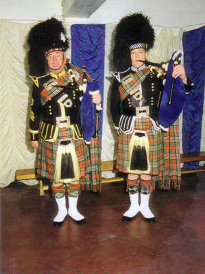 Younger Graeme with his Pipe Major